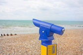 Blue viewfinder telescope at seaside beach — Stock Photo