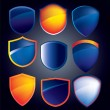 Vector shield collection with glossy reflections in blue and ora — Stock Photo