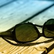 Sunglasses on wood - Stock Photo
