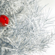 Christmas red ball on snowy conifer — Stockfoto