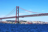 The traditional bridge over the river tagus (tejo) — Stock Photo