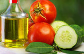 Olive oil, tomato and cucumber — Stock Photo