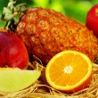 Fruits on green background - Stock Photo