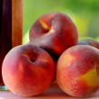 Ripe peaches and liquor - Stock Photo
