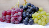 Different variety of grape on table — Stock Photo