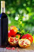 Red wine and pomegranates — Stock Photo