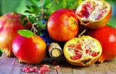 Ripe Pomegranates on table and wine — Stock Photo