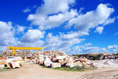 Marble quarry and clouds on blue sky. — Stock Photo