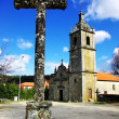 Old cross and portuguese chapel. - Stock Photo