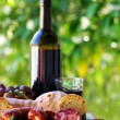 Meat, bread and wine on table — Stock Photo