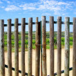 Closed gate in entrance of farm — Stock Photo #24927679