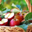 Ripe apples and leaves on basket — Stock Photo