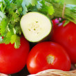 Stock Photo: Tomato, cocumber and cilantro herbs on basket