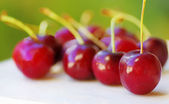 Fresh cherries on table — Stock Photo