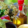 Bottle of oliveoil and fresh vegetables — Stock Photo #29318549
