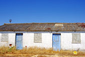 Abandoned facade ,no windows,blue doors in Portugal — Stock Photo