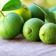 Stock Photo: Green lemons and orange fruits