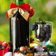 Decorated bottle of red wine with Christmas presents. — Stock Photo #34969101