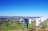 Clothes line against a landscape of Portugal — Stock Photo