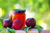 Ripe plum and fresh compote — Stock Photo