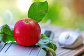 Laptop on a  table with apple  — Stockfoto