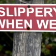 Stock Photo: Slippery when wet sign