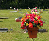 Flower bouquet at grave site — Stock Photo