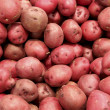 Stock Photo: Red potatoes background