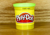 Plastic container of green Play- Doh — Stock Photo
