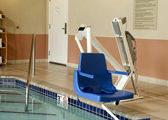 Handicapped pool lift — Stock Photo