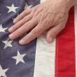 Man with hand on USA flag — Stok fotoğraf #10927507