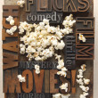 Постер, плакат: Words related to movies with popcorn