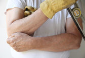 Painful elbow on workman — Stock Photo