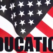 Education word on American flag - Stock Photo