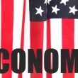 U.S. flag with economy word - Stock Photo