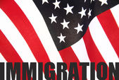 American flag with immigration word — Stock Photo