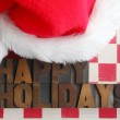 Santa Claus hat with happy holidays words — Stock Photo