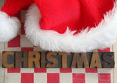 Christmas word with Santa Claus hat — Stock Photo