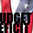 Stock Photo: USflag with budget deficit words