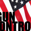 American flag with gun control words - Stock Photo
