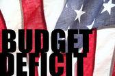 USA flag with budget deficit words — Stock Photo