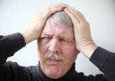 Senior with flu symptoms — Stock Photo