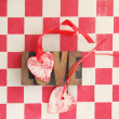 Stock Photo: Red and white checks with hearts and love word