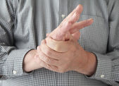 Man with numbness in hand — Stock Photo