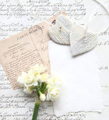 Old script with flowers and hearts — Stock Photo