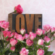 Love word in wood type with roses — Stock Photo #22470463