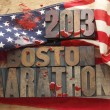 Bloody American flag with Boston Marathon words — Stock Photo