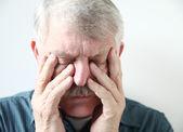 Senior suffering from sinus pressure — Stock Photo