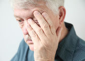 Tired man rubbing his eye — Stock Photo
