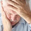 Mature man has severe headache — Stock Photo